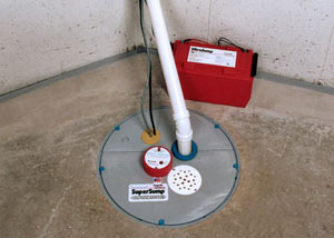 A sump pump system with a battery backup system installed in Effort